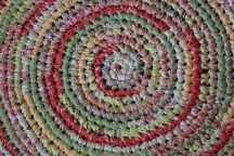 "39"" Round Braided Rug $189.00 Beautiful, handmade one of a kind rug. Wow! How cute will this be in your child's room? Cotton, machine washable."