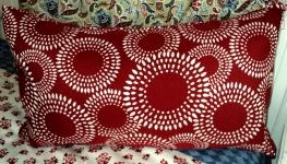 "Red Bursting Pillow $89.00 13 1/2""Hx24""Wide"