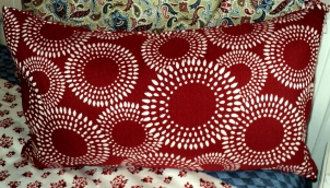 "Red Bursting Pillow $89.00 13 1/2""Hx24""Wide"